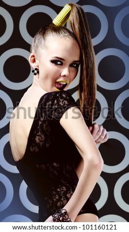 Vertical portrait of a stylish girl enjoying herself - stock photo