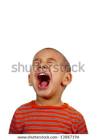 Vertical portrait of a young boy yelling - stock photo