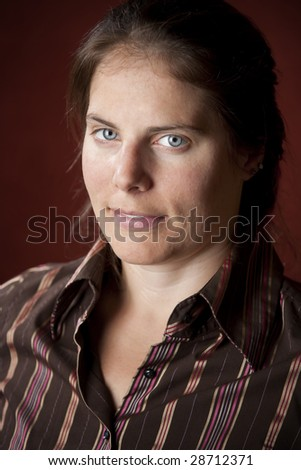 Vertical portrait of an attractive young brunette woman - stock photo