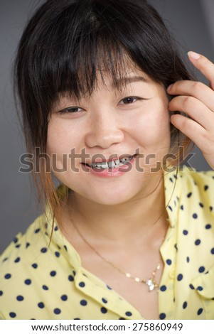 Vertical portrait of beauty Asian happy girl - stock photo