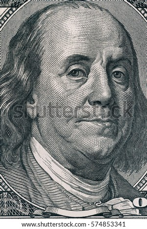 Vertical portrait of Benjamin Franklin's face on the US 100 dollar bill. Macro shot.