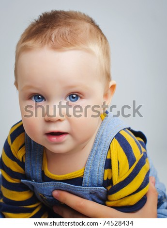 Vertical portrait of cute little boy