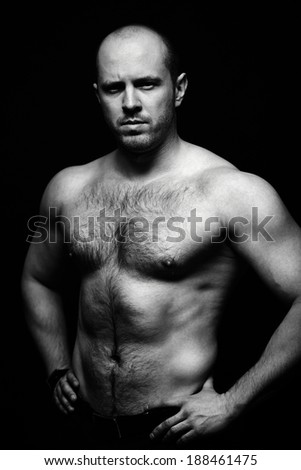 Vertical portrait of shirtless man posing for camera - stock photo