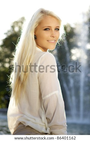 Vertical portrait shot of a young beautiful girl in the 20s. - stock photo