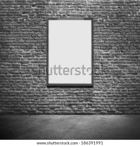 Vertical poster on textured wall. Blank template - stock photo