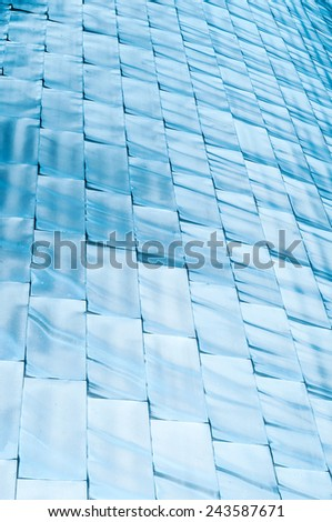 Vertical rows of shining blue blocks. Shimmering cubes in different tints of blue. Sparkling azure bricks as backdrop. Abstract backgrounds and wallpapers. - stock photo
