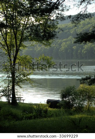 vertical scene of a lake with mountains - stock photo