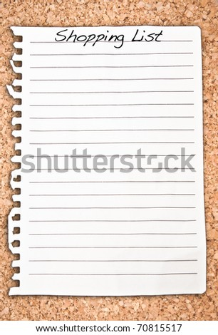 Vertical shopping list on cork background - stock photo