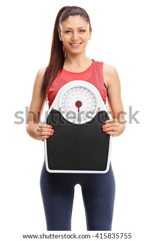 Vertical shot of a beautiful woman holding a weight scale isolated on white background - stock photo