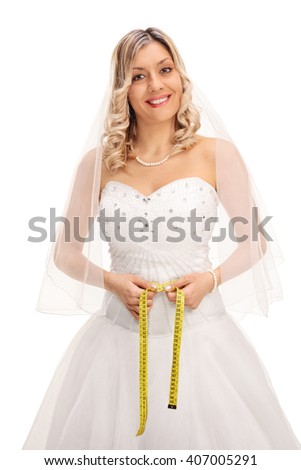 Vertical shot of a blond bride measuring her waist with a yellow measuring tape isolated on white background - stock photo