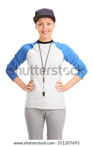 Vertical shot of a blond female baseball coach with a whistle around her neck isolated on white background - stock photo