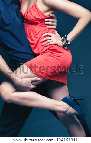 Vertical shot of a dancing couple captured in a dynamic motion - stock photo