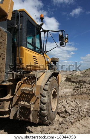 Vertical shot of a dumper truck in a quarry environment. - stock photo