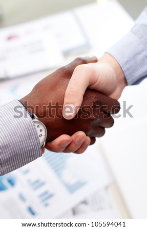 Vertical shot of a firm business handshake guaranteeing safety and evoking trust - stock photo