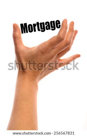 """Vertical shot of a hand holding the word """"Mortgage"""" between two fingers, isolated on white. - stock photo"""