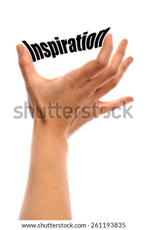 "Vertical shot of a hand squeezing the word ""Inspiration"" between two fingers, isolated on white. - stock photo"