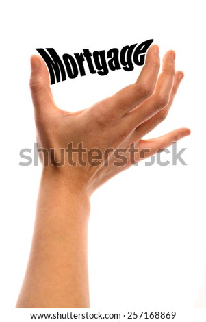 """Vertical shot of a hand squeezing the word """"Mortgage"""" between two fingers, isolated on white. - stock photo"""