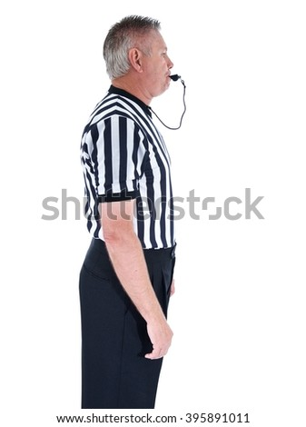 Vertical shot of a professional basketball referee in black and white striped uniform with hands at his sides and blowing a whistle on an isolated white background - stock photo