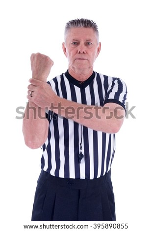Vertical shot of a professional basketball referee in black and white striped uniform with hands up making a call on an isolated white background - stock photo