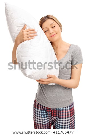 Vertical shot of a young blond woman hugging a pillow and sleeping isolated on white background - stock photo