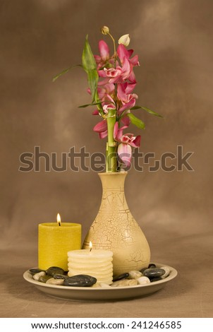 Vertical Shot Of Aromatherapy Concept With Candles And Massage Stones - stock photo