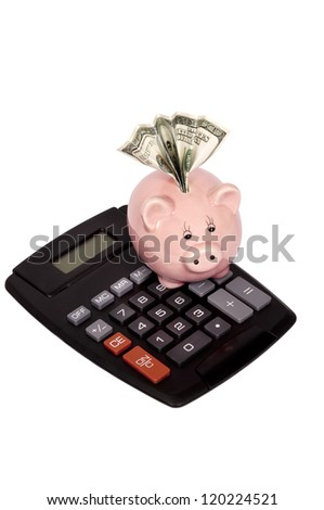 Vertical shot of calculator with piggy bank and hundred dollar bill in slot.  Isolated on white. - stock photo