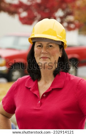 Vertical Shot Of Female Construction Worker - stock photo