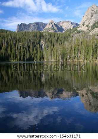 Vertical shot of lake reflection, Fern Lake, Rocky Mountain National Park - stock photo