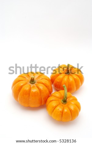 Vertical shot of Pumpkins over white background for halloween - stock photo