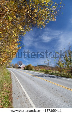 Vertical shot of rural highway in autumn