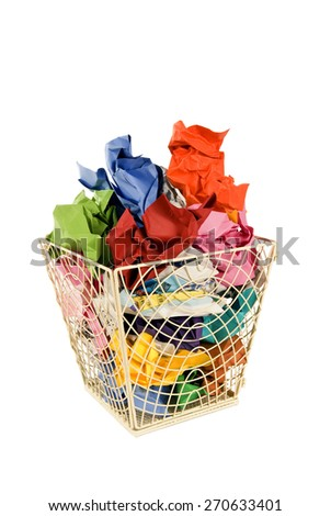 Vertical shot of wastebasket or trash can full of colorful trash/ Big Wastebasket Full Of Trash - stock photo