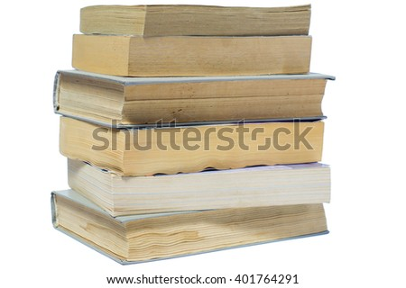 Vertical stack of old books isolated on white background. Stack of books in hard and soft cover.  - stock photo
