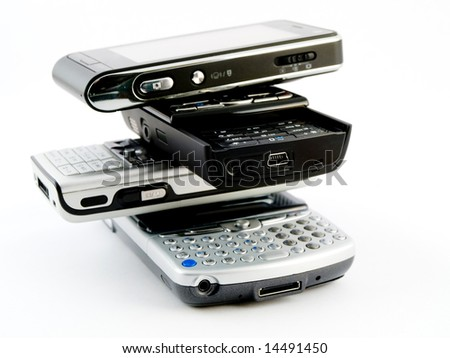 Vertical Stack Pile of Several Modern Mobile Phones PDA Cell Handheld Units Isolated on White Background - stock photo