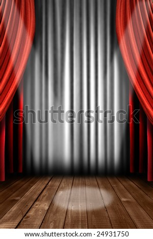 Vertical Stage Drapes With Dramatic Spotlight in the Center - stock photo