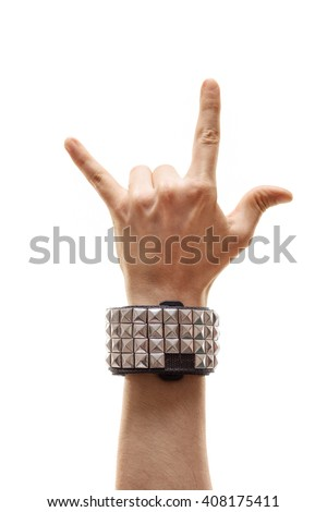 Vertical studio shot of a hand making a rock sign isolated on white background - stock photo
