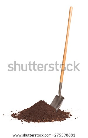 Vertical studio shot of a shovel stuck in a pile of dirt isolated on white background - stock photo