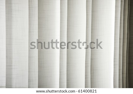 Vertical textile window blinds - jalousie in shades of light brown and grey, stripes background. - stock photo
