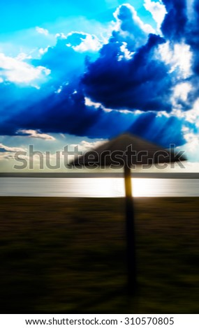 Vertical ubmrella  abstraction on the beach background - stock photo