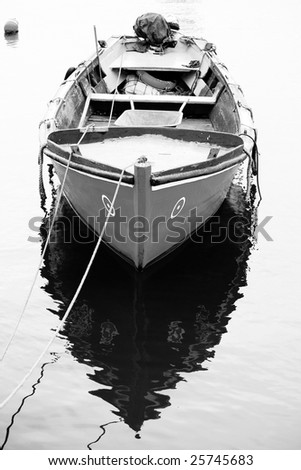 Vertical view of a traditional portuguese fishing boat, anchored on the docks. - stock photo