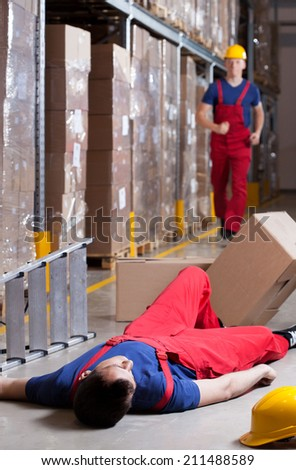 Vertical view of a warehouseman after accident at height - stock photo