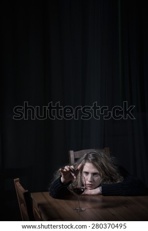 Vertical view of alcohol abuse and addiction - stock photo