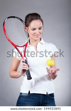 Vertical view of beautiful female tennis player - stock photo