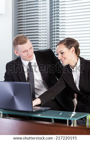 Vertical view of business people looking at laptop