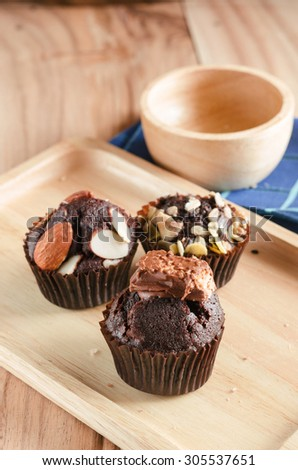 vertical view of cup cakes on wooden  - stock photo