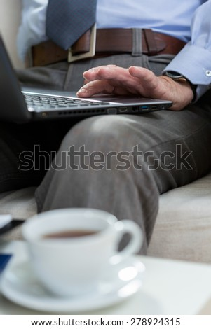 Vertical view of elderly man using laptop - stock photo