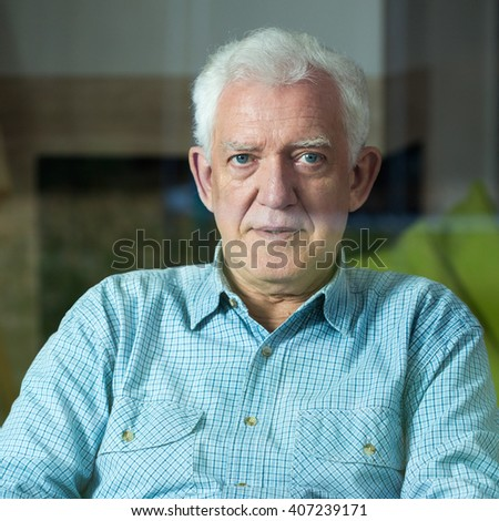Vertical view of elegant senior man on wheelchair - stock photo
