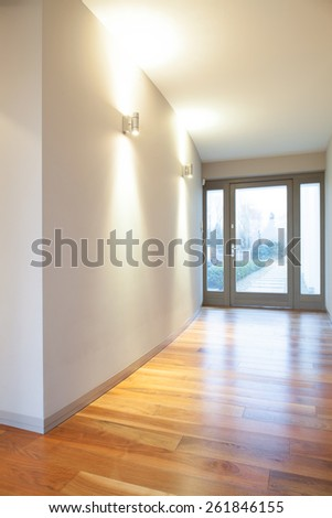 Vertical view of empty hall in residence - stock photo