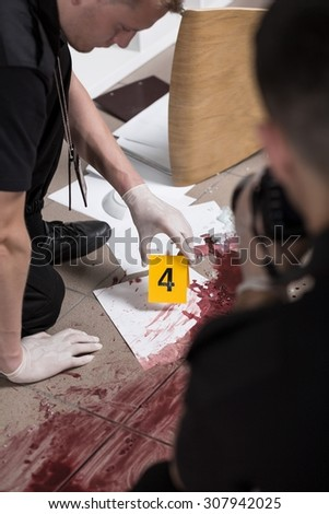 Vertical view of forensic scientist at work - stock photo