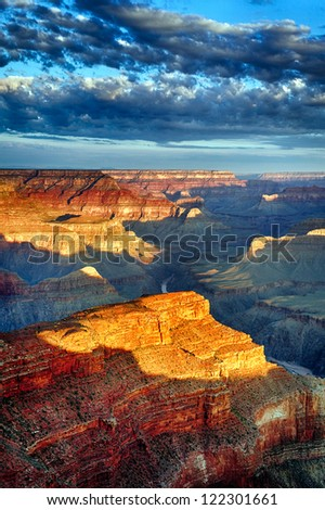 vertical view of Grand Canyon at sunrise in september - stock photo