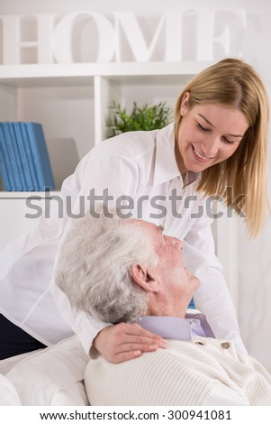 Vertical view of granddaughter caring about grandpa - stock photo